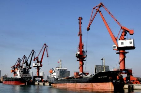 A two-phase model for dry port location with an application to the port of Dalian in China