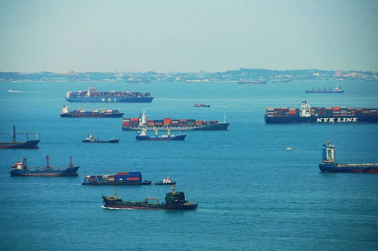 The bottlenecks of global maritime shipping as transshipment clusters